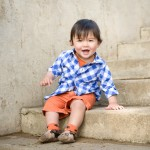 one year old boy sitting on steps photographed by Santa Barbara and San Francisco bay area baby photographer Sarka Photography