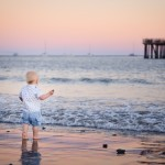 Santa Barbara baby boy standing on the beach at sunset photographed by Santa Barbara and San Francisco bay area baby photographer Sarka Photography
