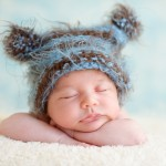 newborn baby sleeping in a hand knitted hat photographed by San Francisco Bay Area and Santa Barbara baby photographer Sarka Photography
