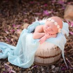 newborn baby sleeping in a wood bucket with photographed by San Francisco Bay Area and Santa Barbara baby photographer Sarka Photography