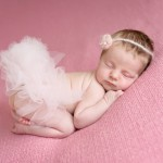 newborn baby girl sleeping on a pink blanket with a pink tutu photographed by San Francisco Bay Area and Santa Barbara baby photographer Sarka Photography
