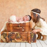 newborn baby girl and her sister with vintage suitcases photographed by San Francisco Bay Area and Santa Barbara baby photographer Sarka Photography