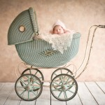 newborn baby girl sleeping in vintage carriage photographed by San Francisco Bay Area and Santa Barbara baby photographer Sarka Photography