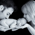 newborn baby boy kissed by his parents photographed by San Francisco Bay Area and Santa Barbara baby photographer Sarka Photography