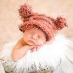 newborn baby boy sleeping in a vintage bucket wearing a hand knitted baby hat photographed by San Francisco Bay Area and Santa Barbara baby photographer Sarka Photography