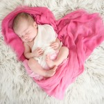 newborn baby sleeping in a heart shaped scarf photographed by San Francisco Bay Area and Santa Barbara baby photographer Sarka Photography