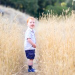 little boy smiling in a golden grassy path photographed by Santa Barbara and San Francisco Bay area photographer Sarka Photography