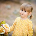 little girl holding flowers photographed by Santa Barbara and San Francisco Bay area photographer Sarka Photography