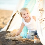 little girl peeking from a beach tent photographed by Santa Barbara and San Francisco Bay area photographer Sarka Photography