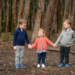 siblings holding hands in a woodsy photographed by Santa Barbara and San Francisco Bay area photographer Sarka Photography