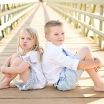 children sitting in a wooden bridge path photographed by Santa Barbara and San Francisco Bay area photographer Sarka Photography
