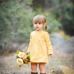 little girl holding flowers in a park photographed by Santa Barbara and San Francisco Bay area photographer Sarka Photography