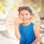 little girl holding umbrella photographed by Santa Barbara and San Francisco Bay area photographer Sarka Photography