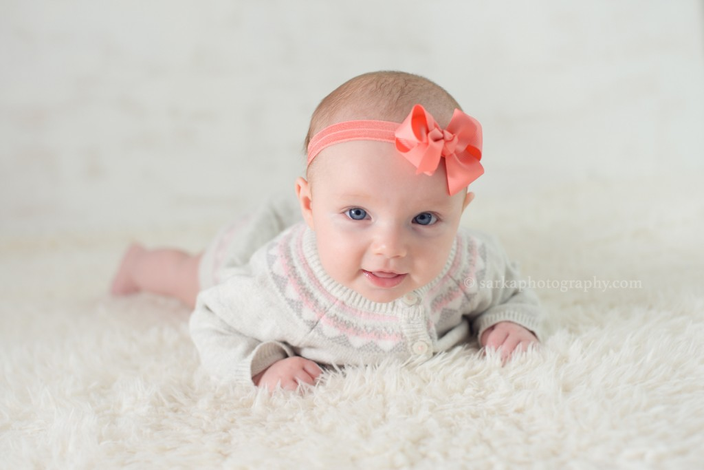 4month old baby girl wearing a winter sweater dress photographed by Santa Barbara and Bay Area Sarka photography