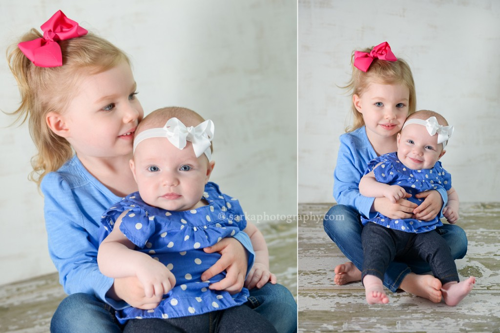 baby girl sitting in her sisters lap photographed by Santa Barbara and Bay Area Sarka photography