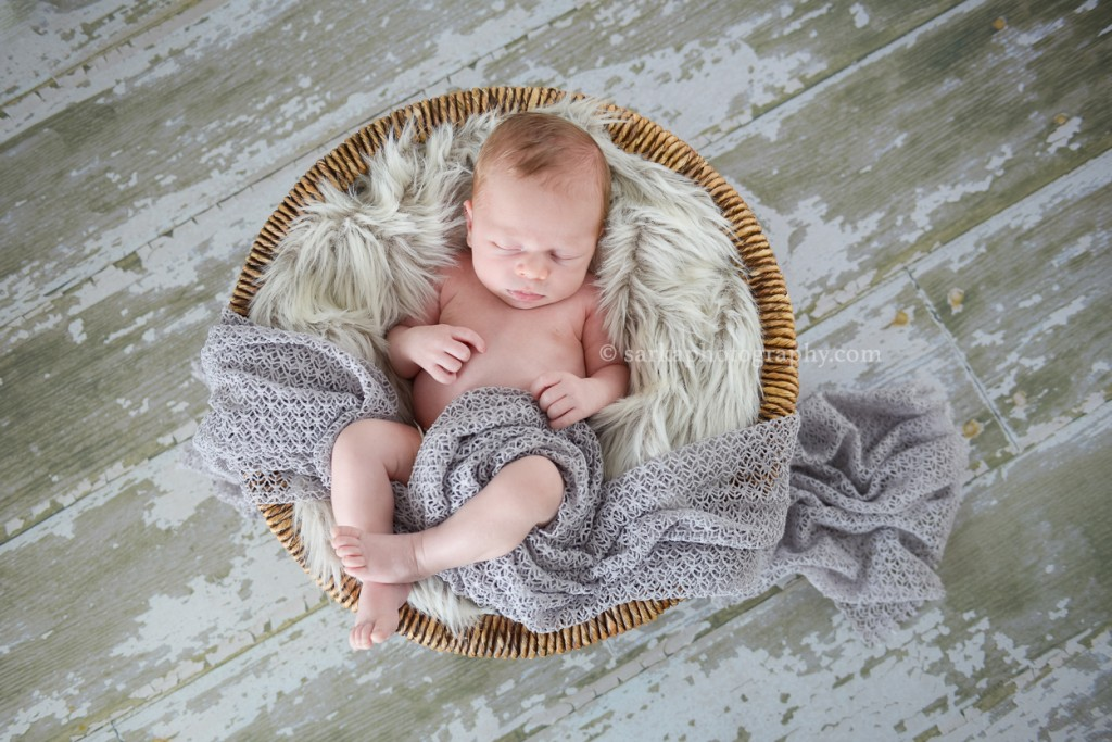 newborn baby boy sleeping in basket photographed by Marin county newborn photographer