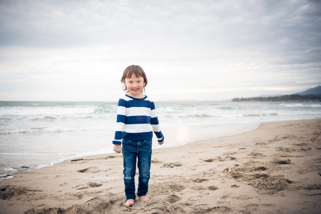 little girl in a striped shirt on the beach photographed by Santa Barbara children and family photographer by Sarka Photography