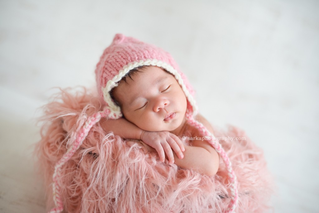 newborn baby girl sleeping wearing hand knitted pink hat photographed by Santa Barbara and San Francisco Bay area photographer Sarka