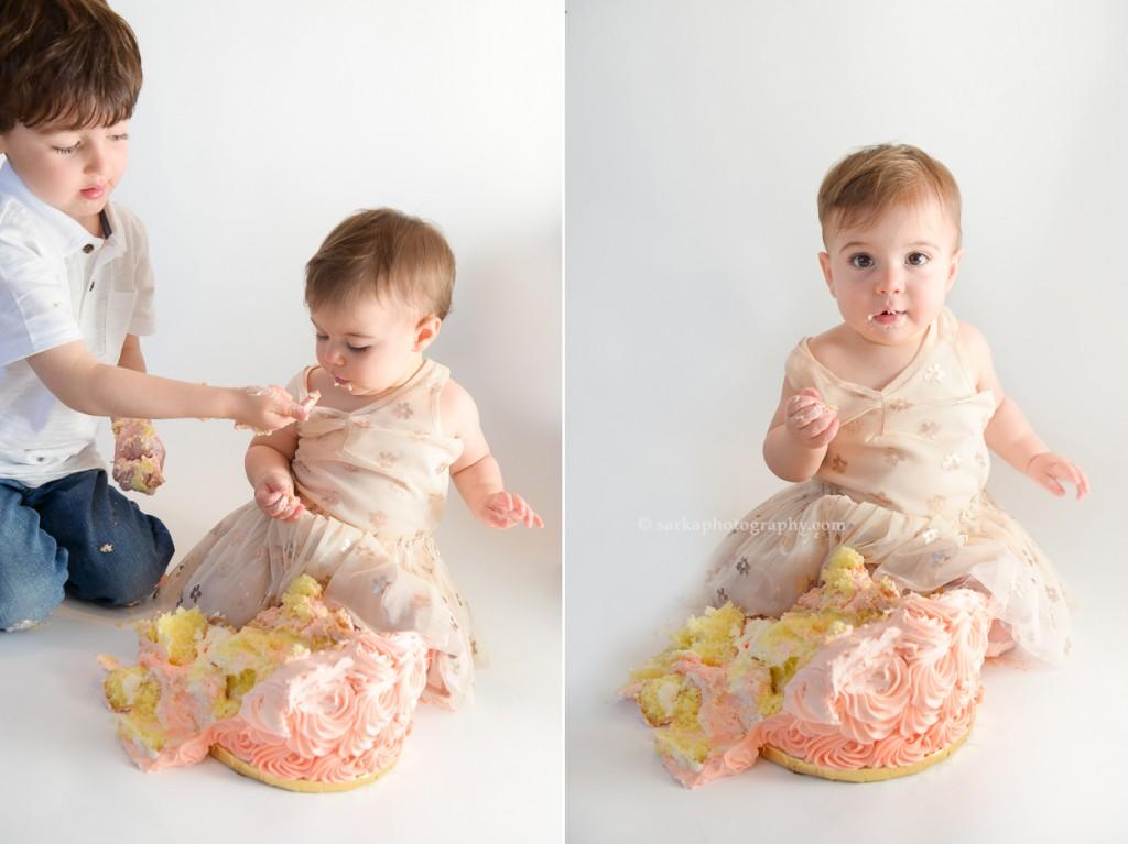 one year baby girl smashing birthday cake photographed by San Francisco and Santa Barbara baby photographer Sarka