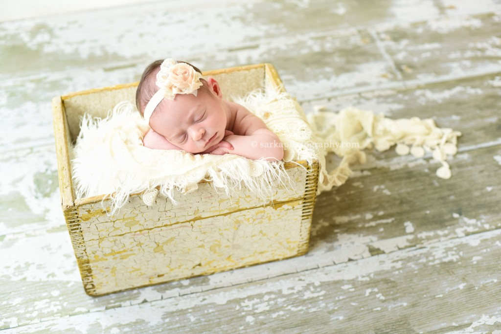 newborn baby girl sleeping in a vintage yellow wood box photographed by San Francisco and Santa Barbara newborn baby photographer Sarka photography