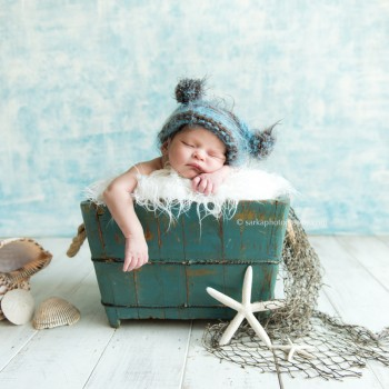newborn baby boy sleeping in a vintage wood box nautical theme by Santa Barbara Montecito newborn photographer sarkaphotography