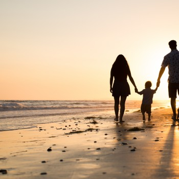 family walking into the sunset by Santa Barbara children photographer sarka photography