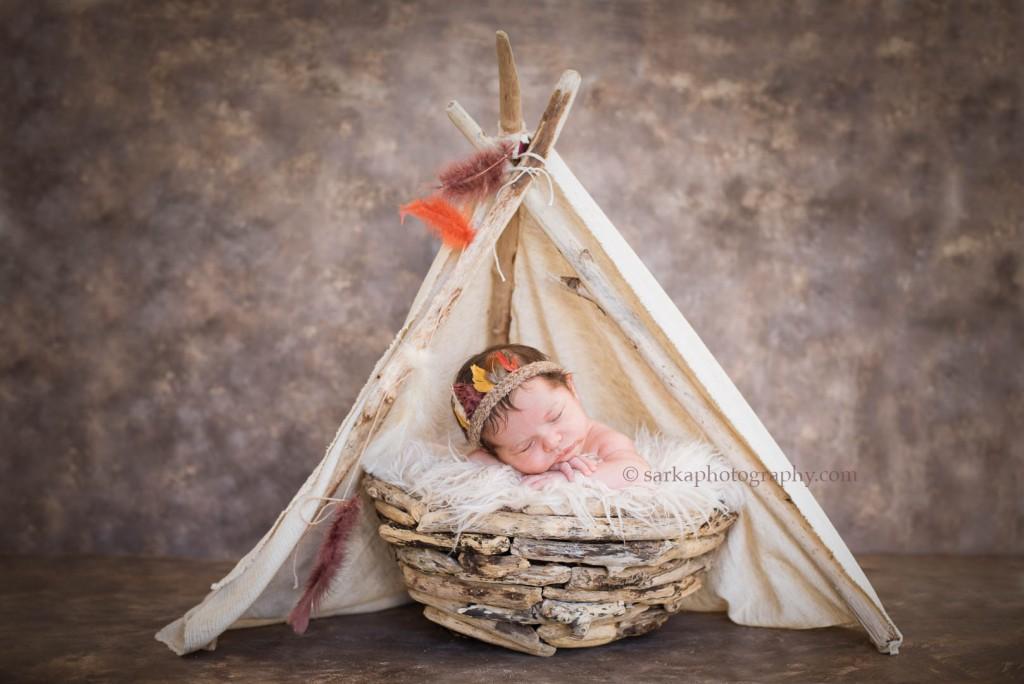 newborn baby boy sleeping in native tee-pee photographed by Santa Barbara Ojai baby photographer sarkaphotography